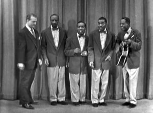 Red Skelton on stage with The Four Knights