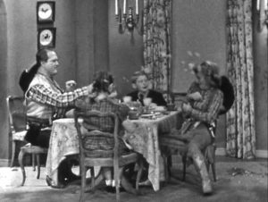 Red Skelton and Shirley having a food fight at the dinner table