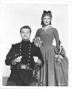 Red Skelton disguised as a Confederate soldier with Arlene Dahl in Southern Yankee