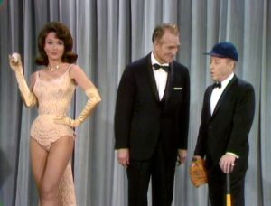 Red Skelton demonstrates his curve ball to George Gobel -- and Francine York wants to know who hit her with this ball!