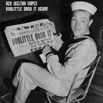 "Red Skelton poses with a newspaper that famously plays on the Mean Little Kid's catchphrase, ""I dood it!"" during World War II, when Jimmy Doolittle led a daring raid on Tokyo"