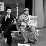 Red Skelton as Freddie the Freeloader, sitting next to Jackie Gleason