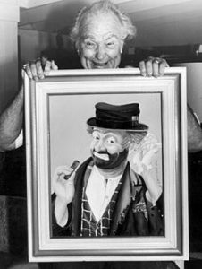 Red Skelton with painting of Freddie the Freeloader