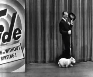 """Red Skelton walking a white dog in """"The Railroad Station"""""""