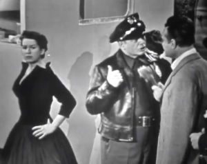 Sadie Murphy (Mary McCarty) is quite pretty when cleaned up … and she and the police officer know each other!