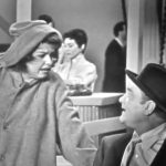 """Sadie Murphy (Mary McCarty) does her sales pitch to the """"restrained"""" Red Skelton in Love Thy Neighbor"""