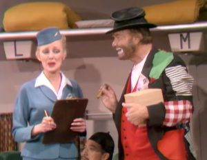 Selma Undercover (Virginia Grey) and Freddie the Freeloader (Red Skelton) on board the plane in The Sweet Smell of Failure