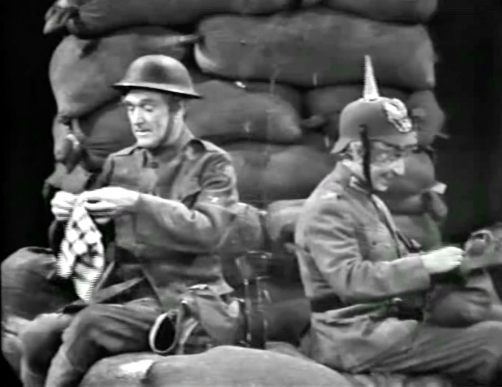 """American soldier Red Skelton, back to back with German soldier Harpo Marx, in World War I - in the Silent Spot, """"Christmas Truce"""""""