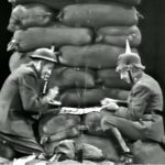 Soldiers Red Skelton and Harpo Marx, on opposite sides, play checkers