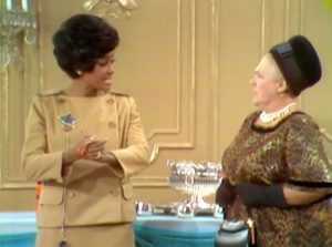 """Store detective Nancy Wison with one of the fashion show attendees in """"Clothes Make the Bum"""""""