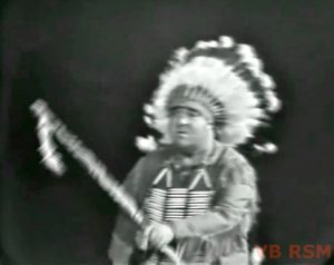 """Stubby Kaye as an Indian Chief, about to meet Pilgrim Red in """"Ten Little Fingers and Twelve Little Toes"""""""
