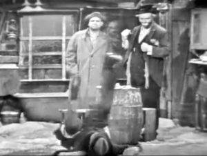 """Gilbert (Vincent Price) throws a tantrum while the hobos (Jackie Coogan, Red Skelton) look on in """"The Original Da Vinci"""""""